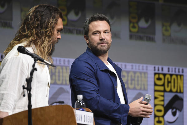 Actors Jason Momoa, left and Ben Affleck speak at Comic-Con. (Richard Shotwell / Invision/Associated Press)