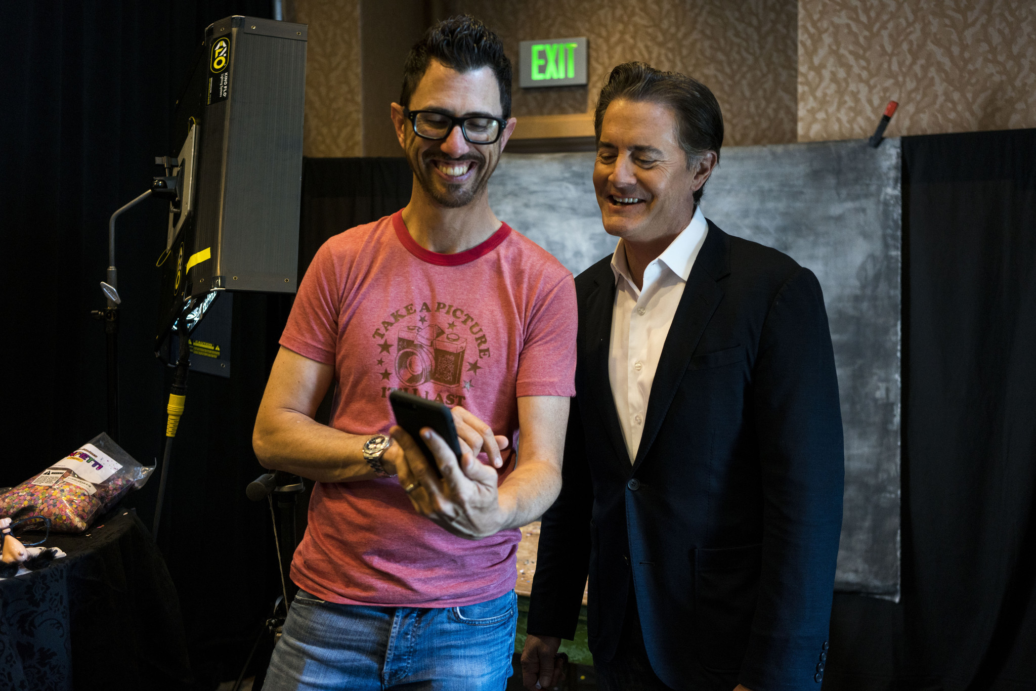 Los Angeles Times photographer Jay L. Clendenin and actor Kyle MacLachlan laugh at the final cut.