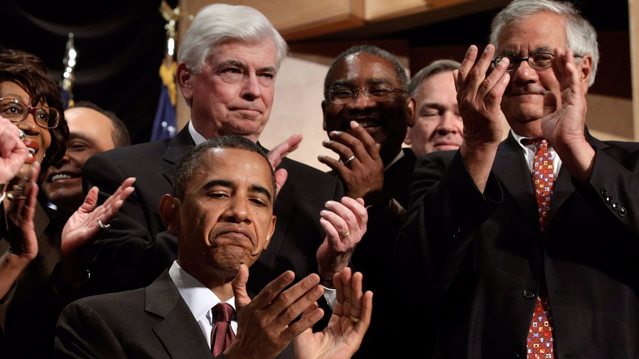 President Obama after signing the Dodd-Frank financial reform bill in 2010, as the law's namesakes, Sen. Christopher Dodd, behind Obama, and Rep. Barney Frank, right, applaud.