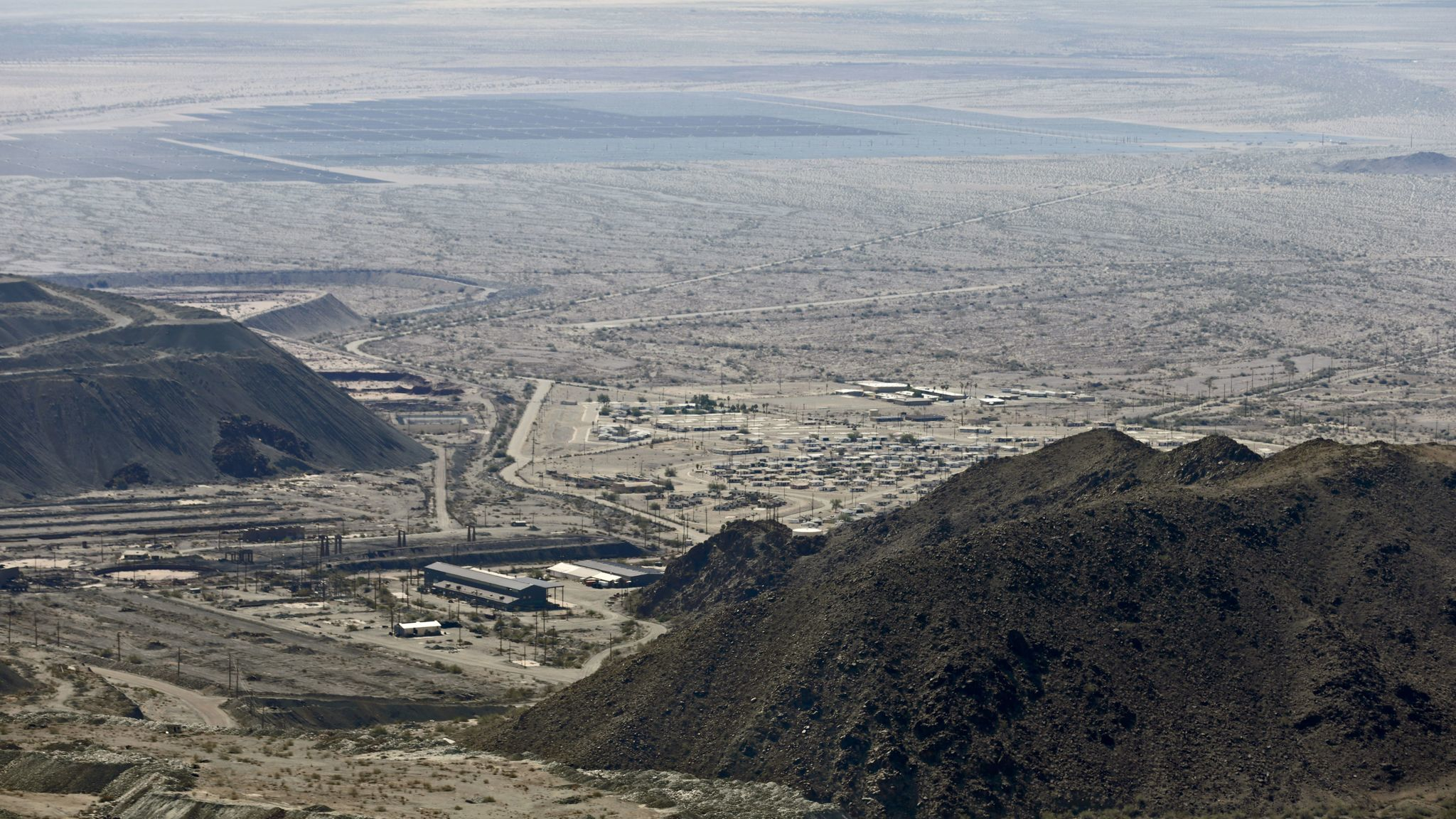 A view of the lower portion of the Eagle Mountain mine site and abandoned company town. A large solar farm is in the distance.