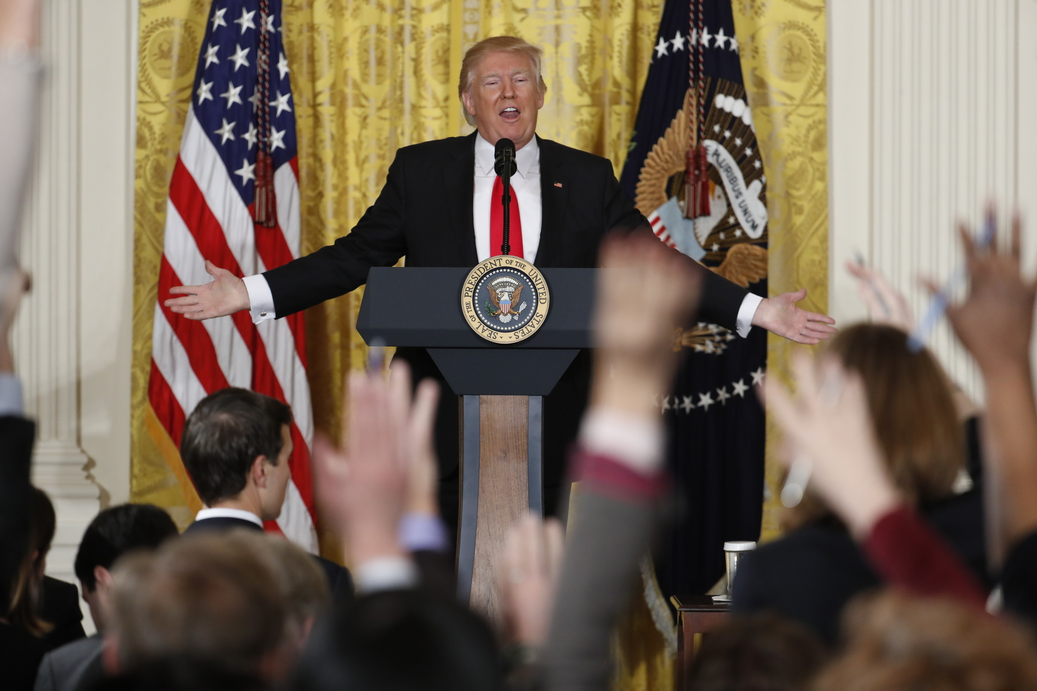 President Trump boasts about his election victory and attacks journalists at a news conference in February.