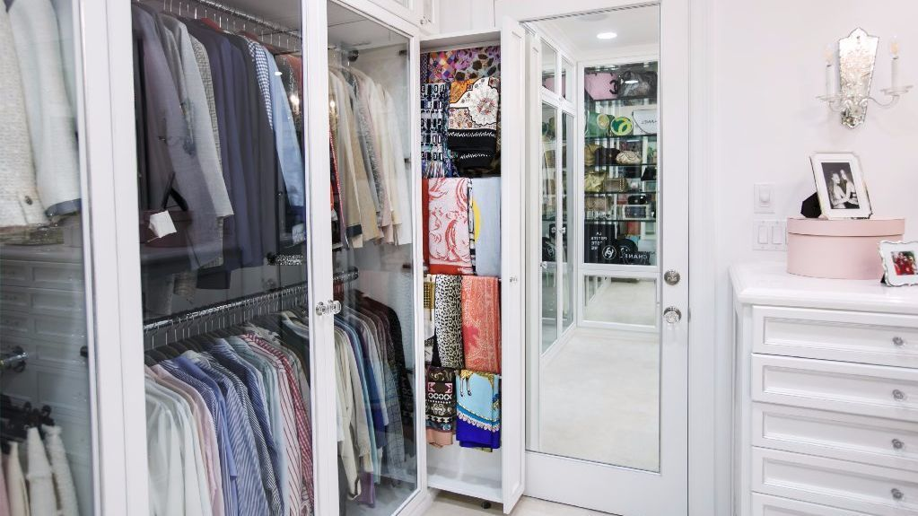 This closet designed by Lisa Adams contains specialized storage for scarves.