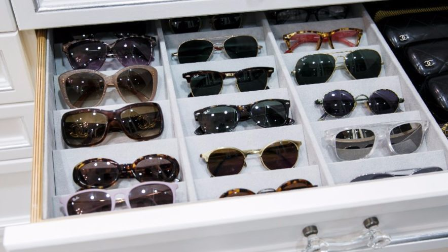 Even eyewear gets a drawer in this closet.