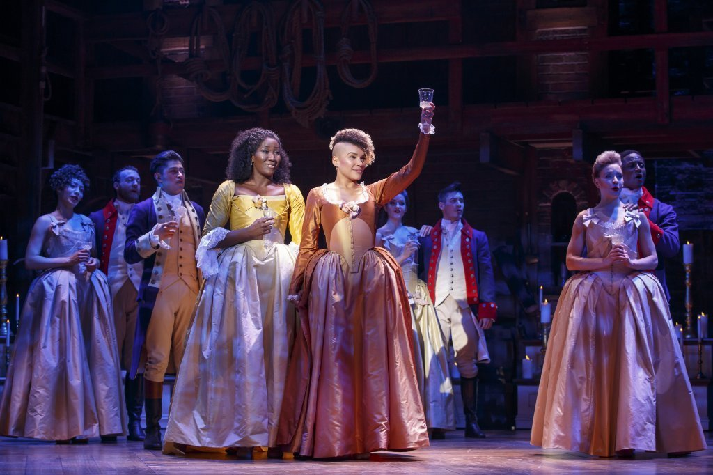 """Hamilton"" in San Francisco with Amber Iman, left, and Emmy Raver-Lampman lifting her glass as Angelica Schuyler."