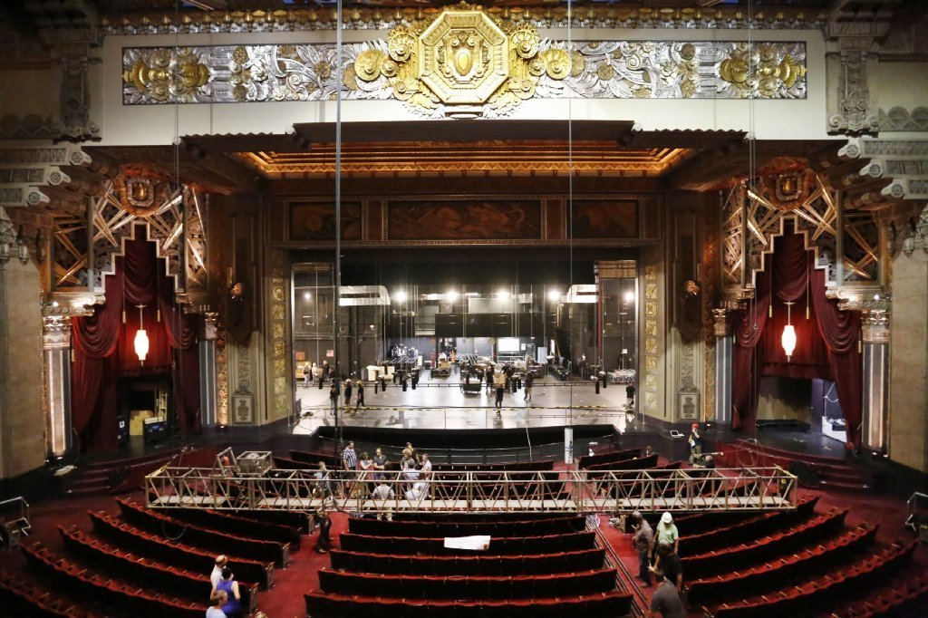 A moving crew installs advance pieces of the set at the Pantages.