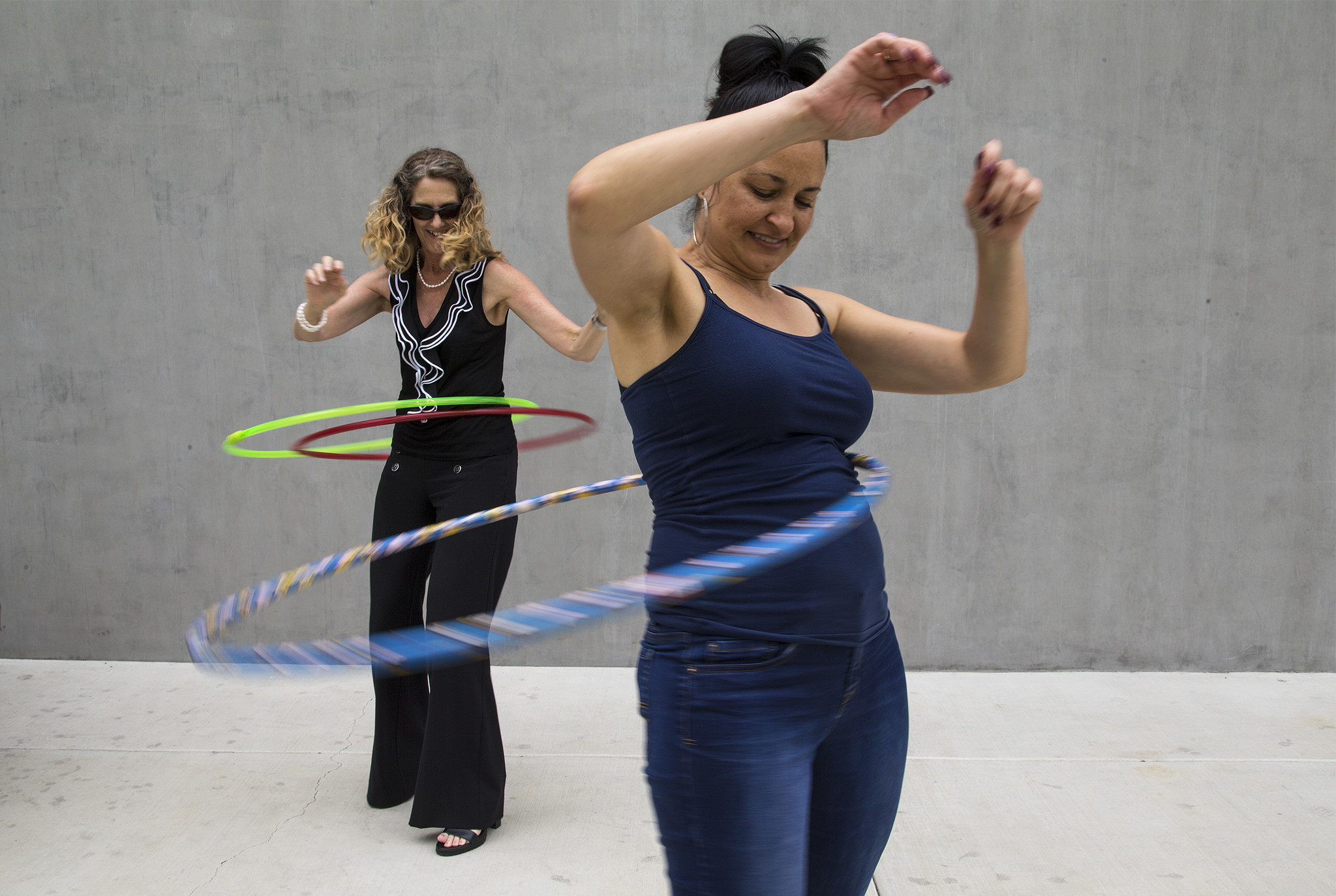 Wham-O employees Nancy Nosko, left, and Tonya von Stenzsch try out the latest Hula Hoops.