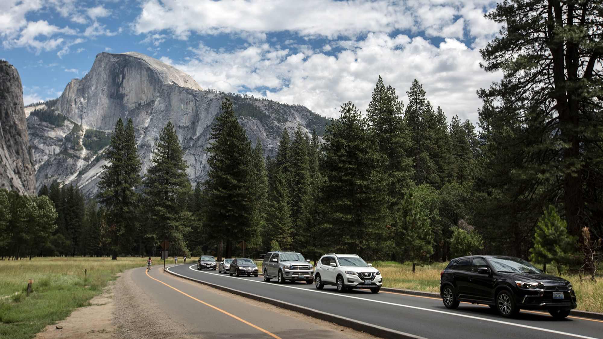 Traffic backs up along the valley floor while a bus lane remains largely open at Yosemite National Park.