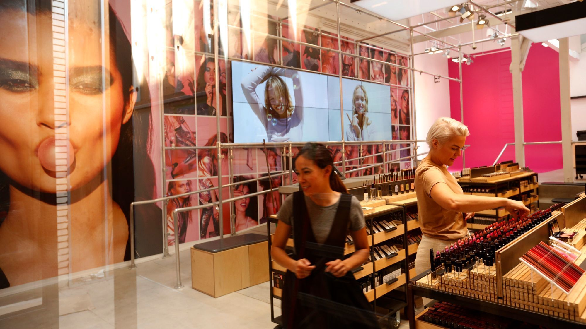 Marlo Messer, left, and Aubrie Slater prepare the new Smashbox store for its recent opening in Venice.