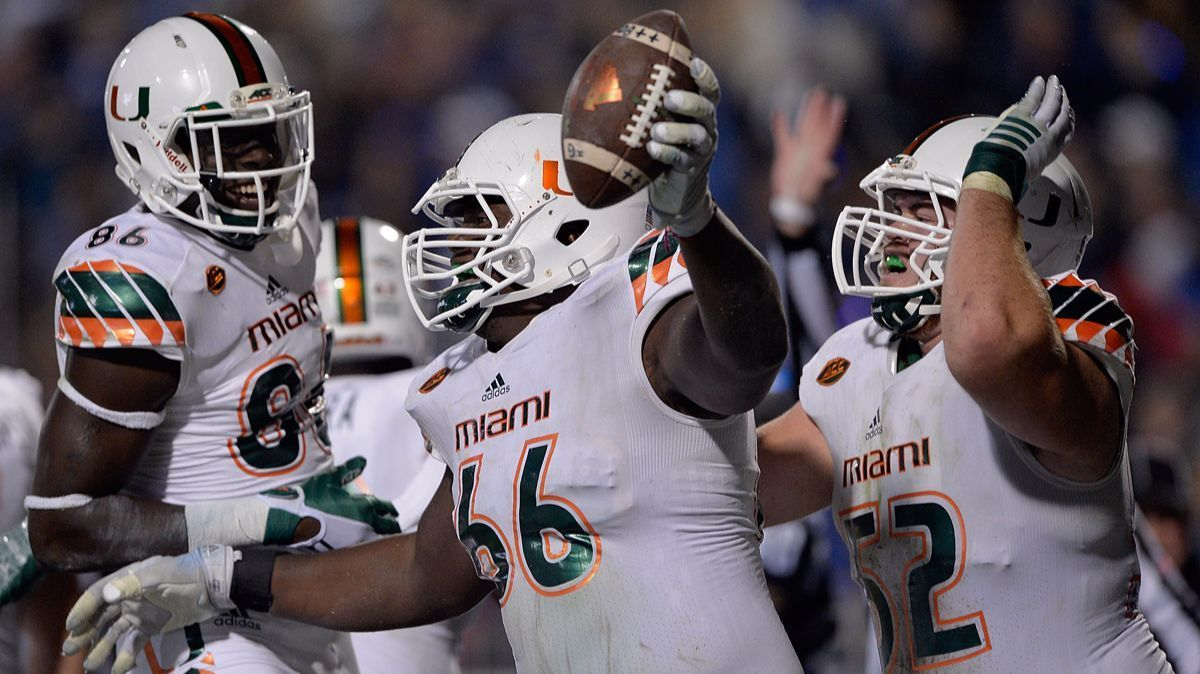 Sunny Odogwu (66) celebrates with teammates after recovering a fumble in the end zone for a Miami Hurricanes touchdown during their game against the Duke Blue Devils on Oct. 31, 2015.