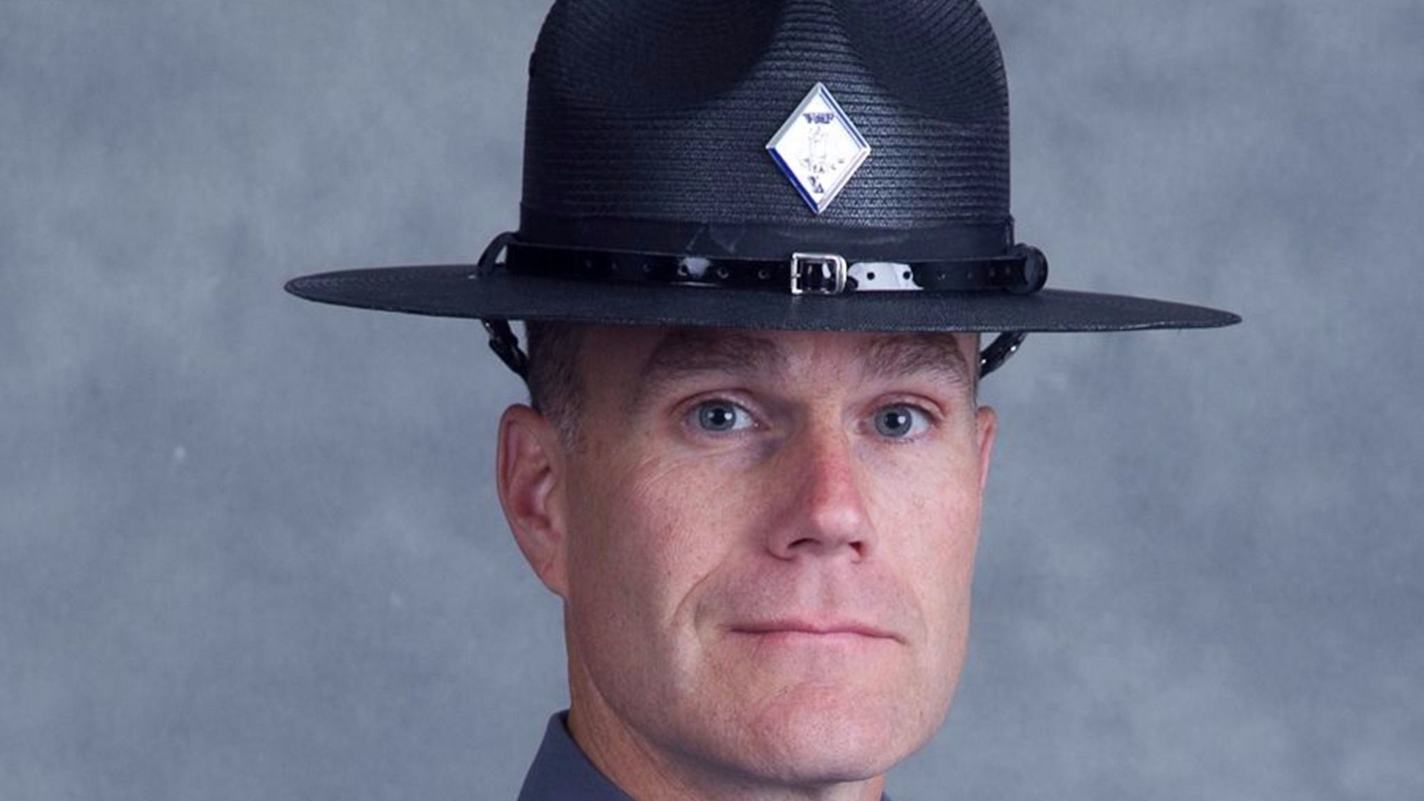 Lt. H. Jay Cullen poses for his official photo. Cullen and Trooper-Pilot Berke M.M. Bates were killed when their helicopter crashed while assisting during the protests in Charlottesville, Va.,
