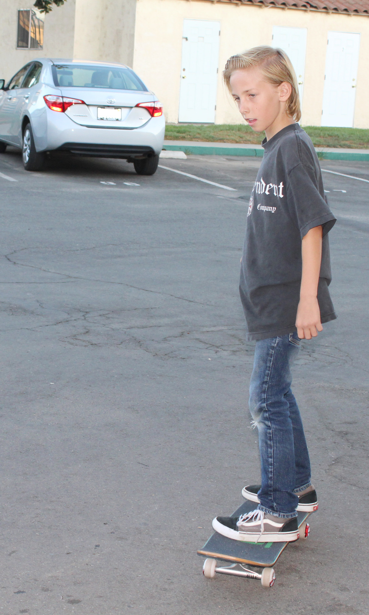 Andrew Hitt tries out his new skateboard.