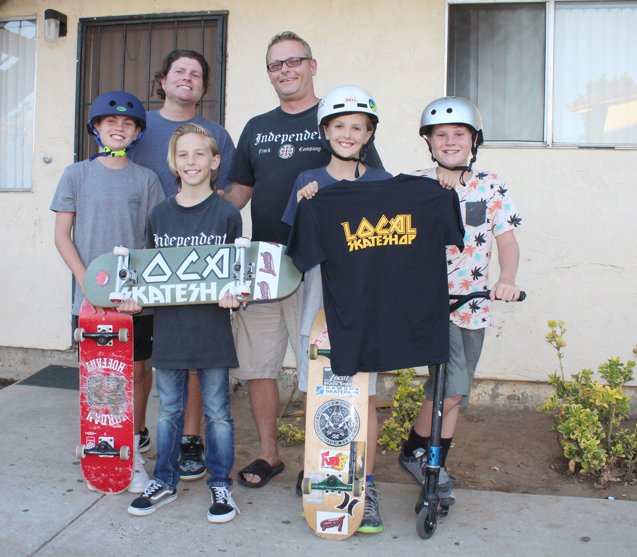 Andrew Hitt holds his new skateboard and Cash England holds Andrew's new Local Skateshop shirt. With them are Garin Sturgeon, Justin Sturgeon, Michael Hitt and Grayson Sturgeon.