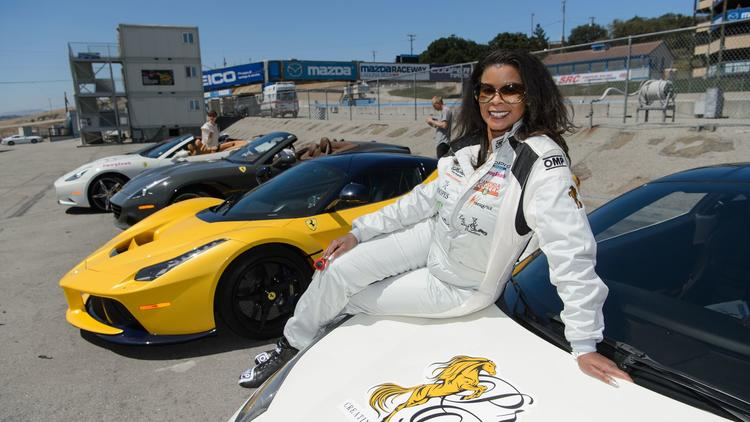 Ferrari owner and car club founder Chanterria McGilbra attends a race event at Monterey's Laguna Sec