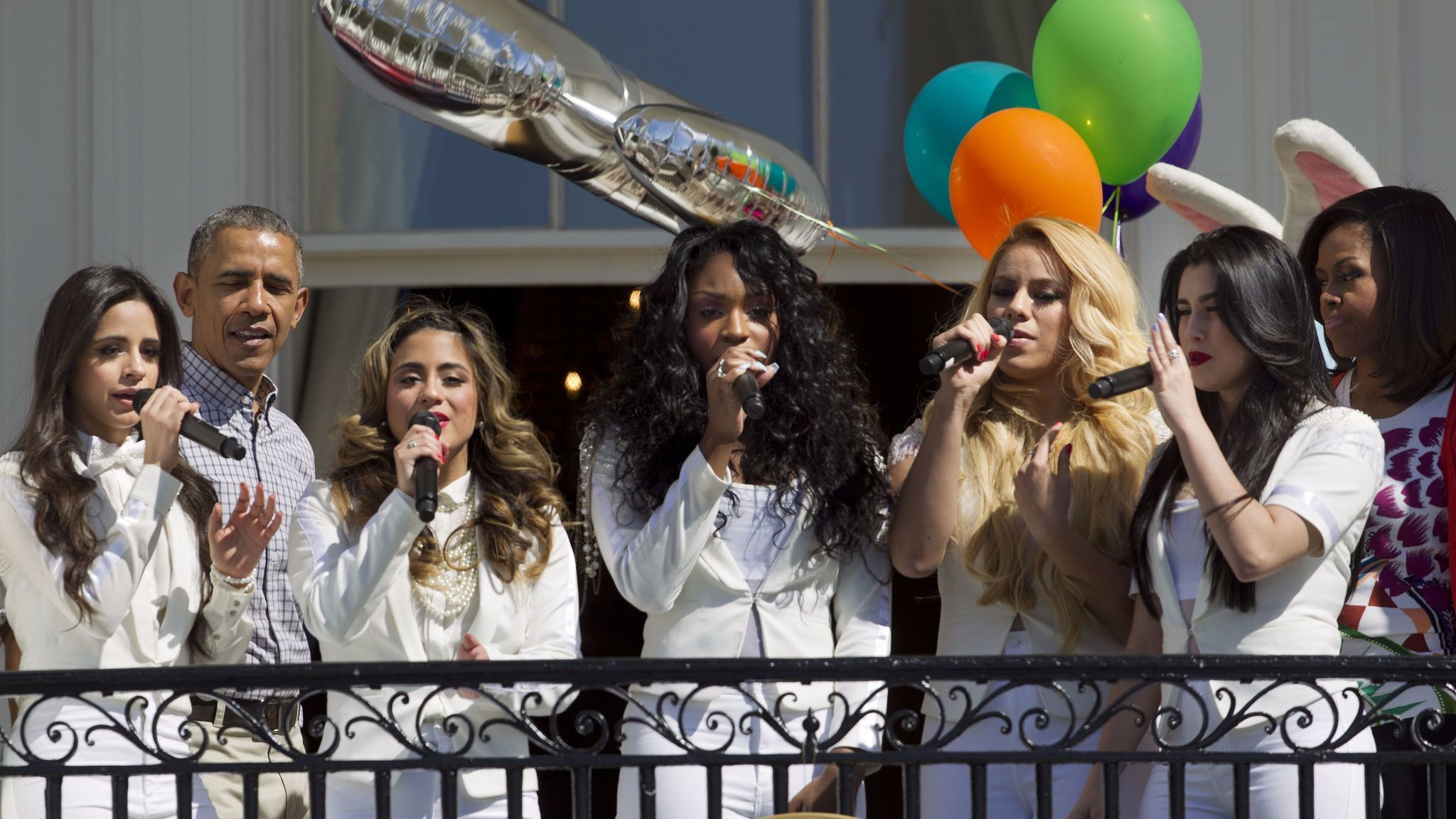 Then-President Obama and then-First Lady Michelle Obama, right, look on as Fifth Harmony performs at the White House in 2015. Camila Cabello (far left) exited in December 2016, amid the group's breakout year.