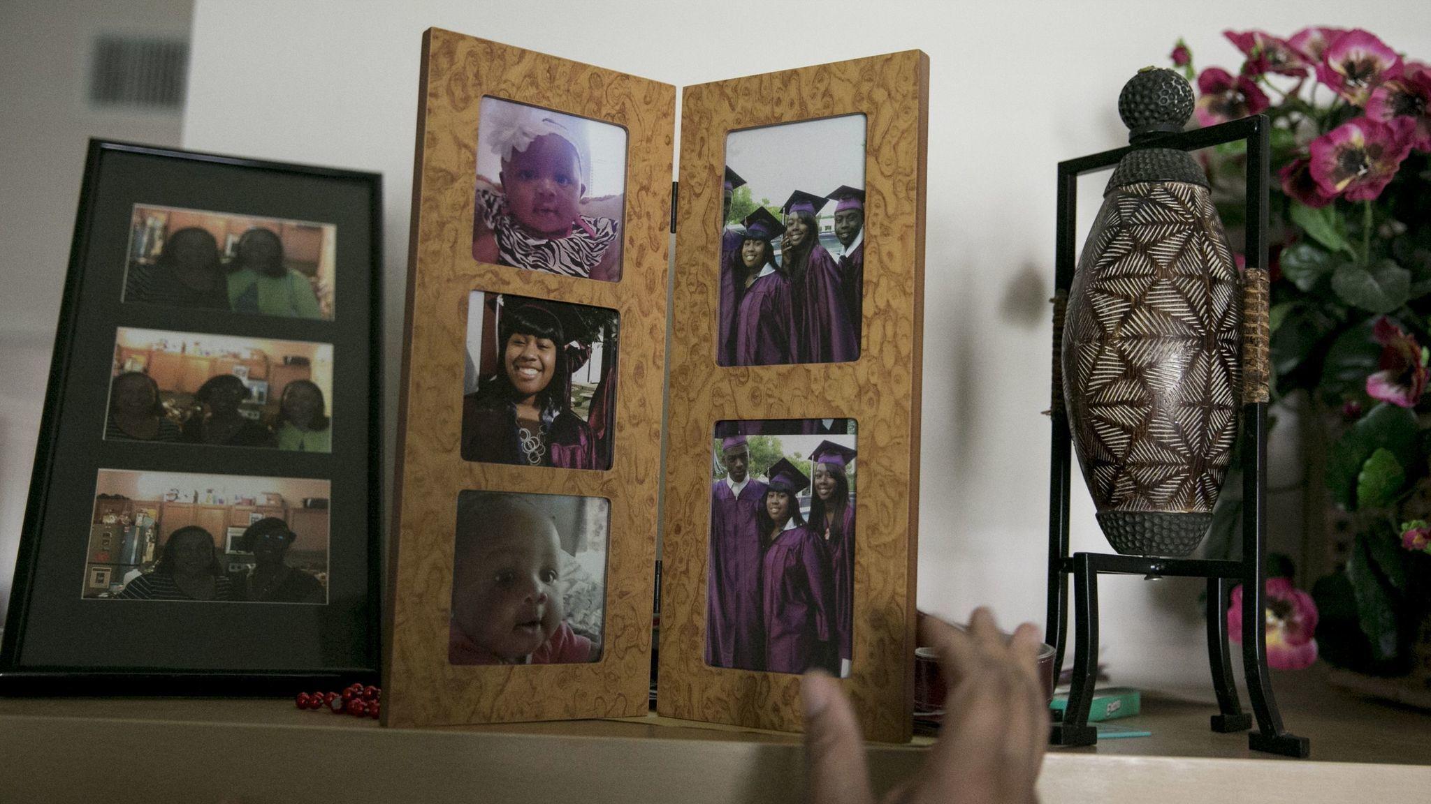 Framed photos of Cassaundra in the family's living room.