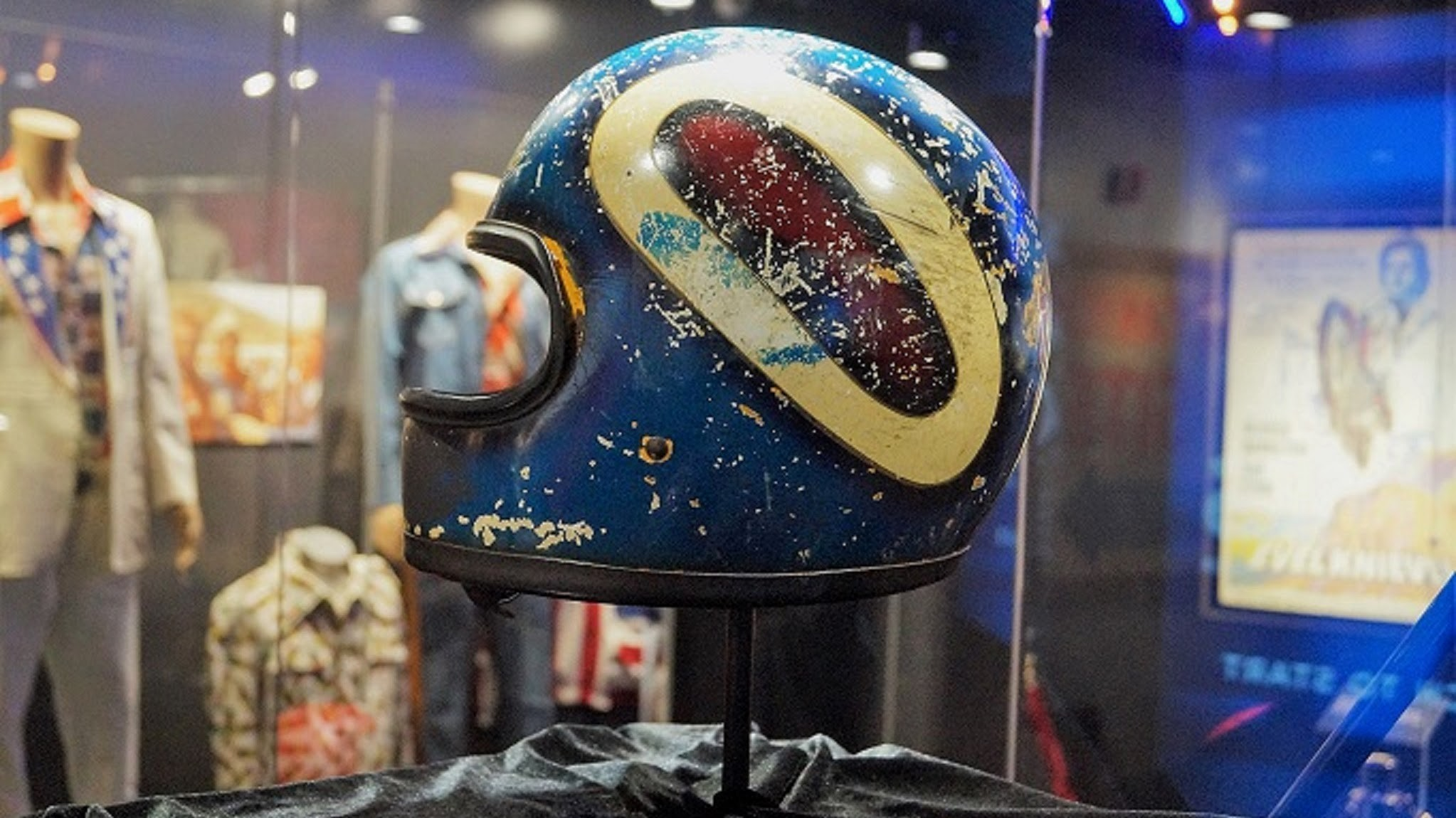 Full of scratches and dings, the helmet Evel Knievel was wearing when he crashed during his famous Las Vegas jump is on display for the first time in decades.