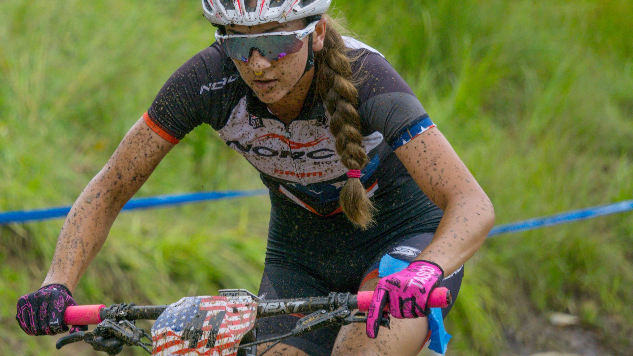 Gwendalyn gibson races through a course full of obstacles.