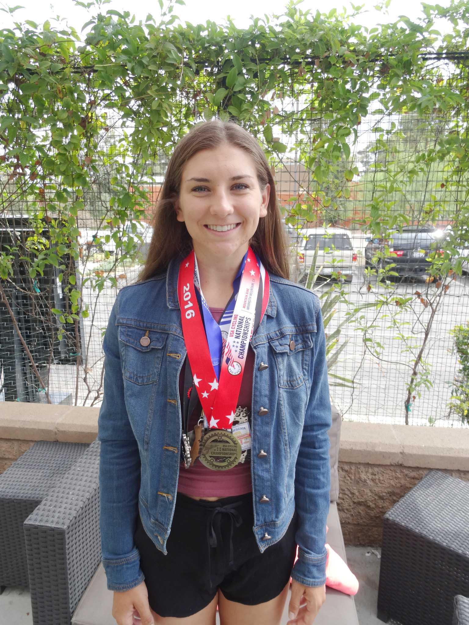 Ramona High School graduate Gwendalyn gibson wears some of the medals she won in national and international mountain bike competitions this summer.