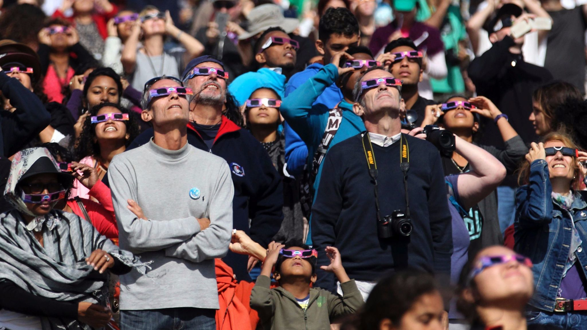Eclipse enthusiasts say it's worth taking a moment to watch others watch an eclipse.
