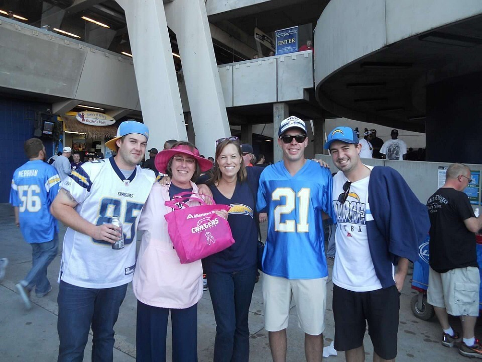 The author with her aunt and cousins at a game.