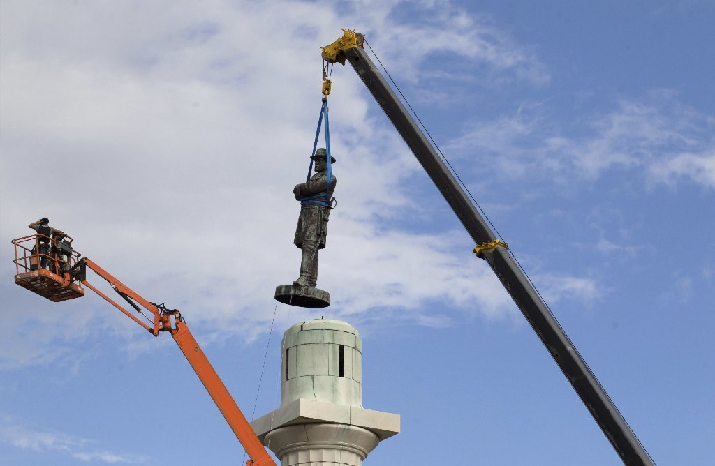 A Confederate monument to Gen. Robert E. Lee was taken down in New Orleans in May.