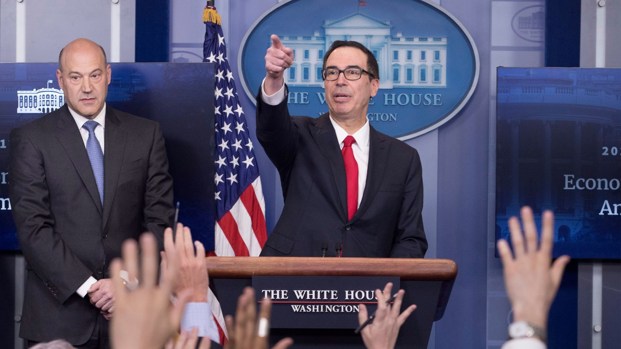 National Economic Director Gary Cohn, left, and Treasury Secretary Steven T. Mnuchin answer reporters' questions about President Trump's tax plan in April.