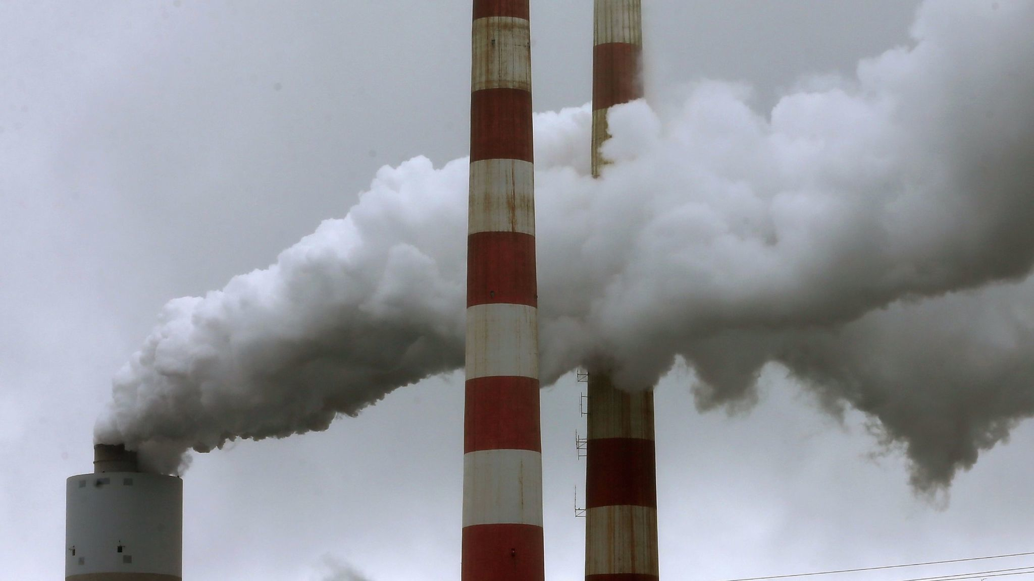 Emissions spew from a large stack at a coal-fired power plant in Newburg, Md.