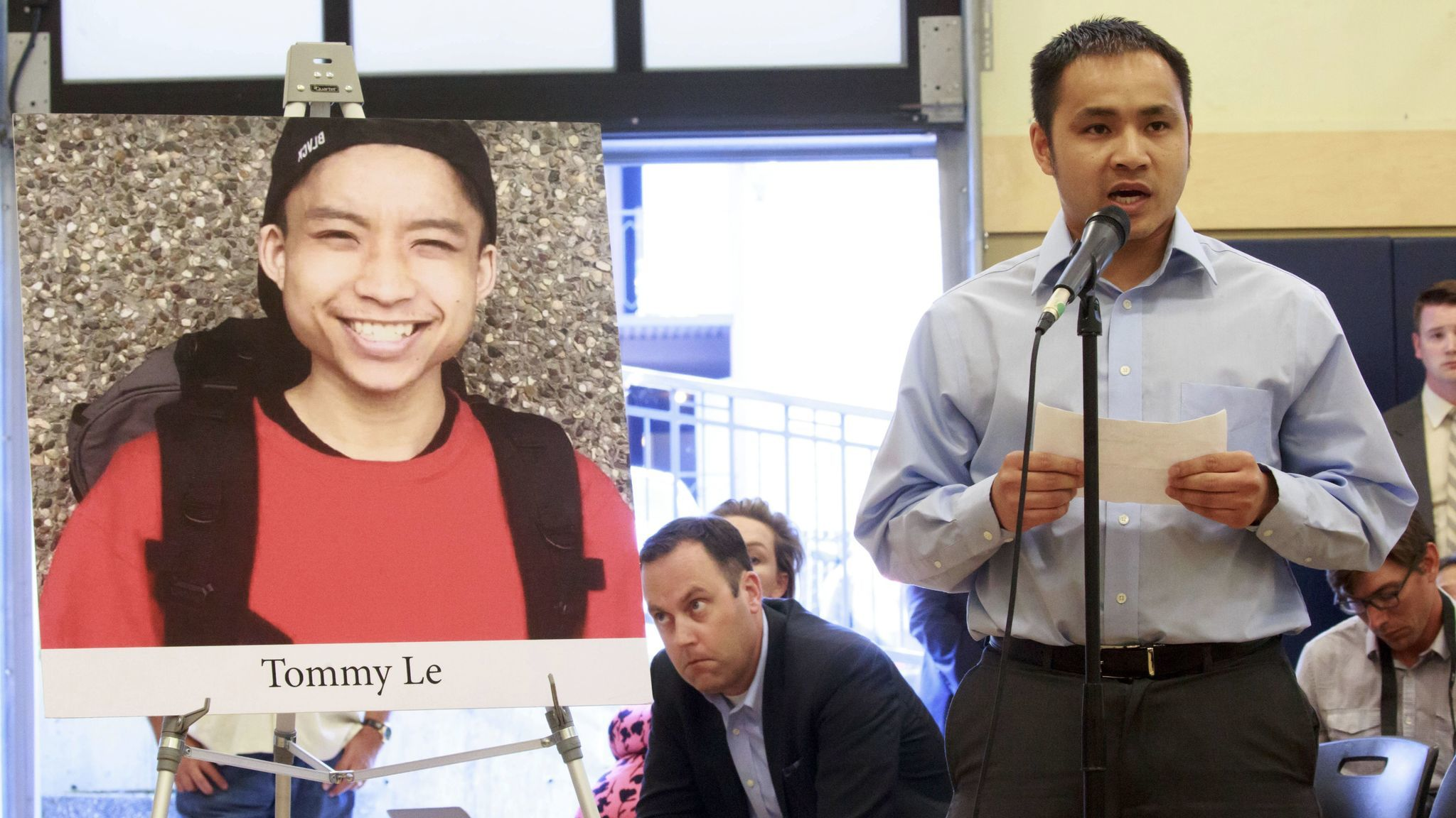 Tommy Le's brother Quoc Nguyen speaks at a community forum in July over Le's death.