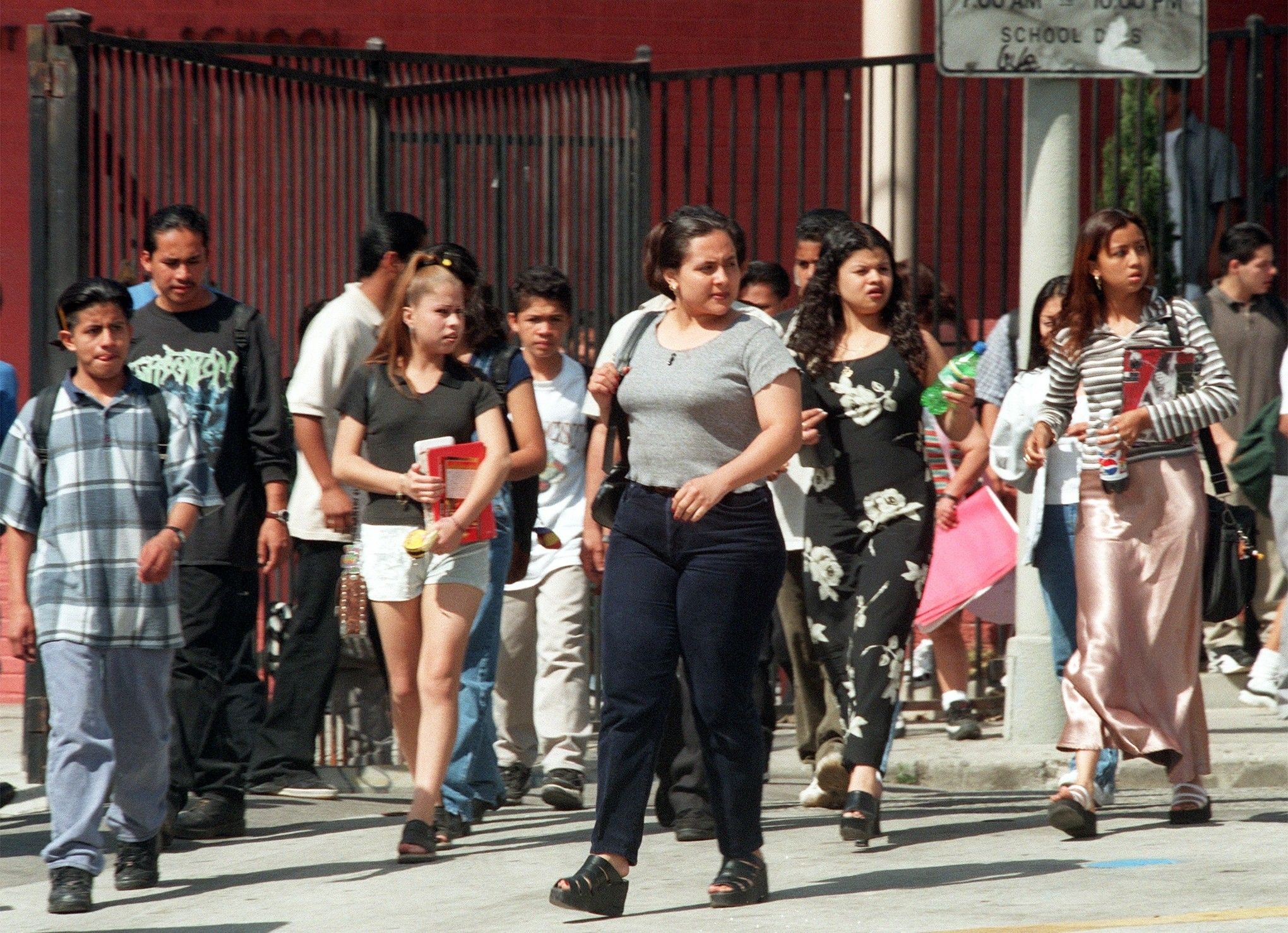 Students leaving Belmont High School, west of downtown, in 1997. Before the new schools opened, it served more than 5,000 students for nine years. Others had to be bused out of the neighborhood.