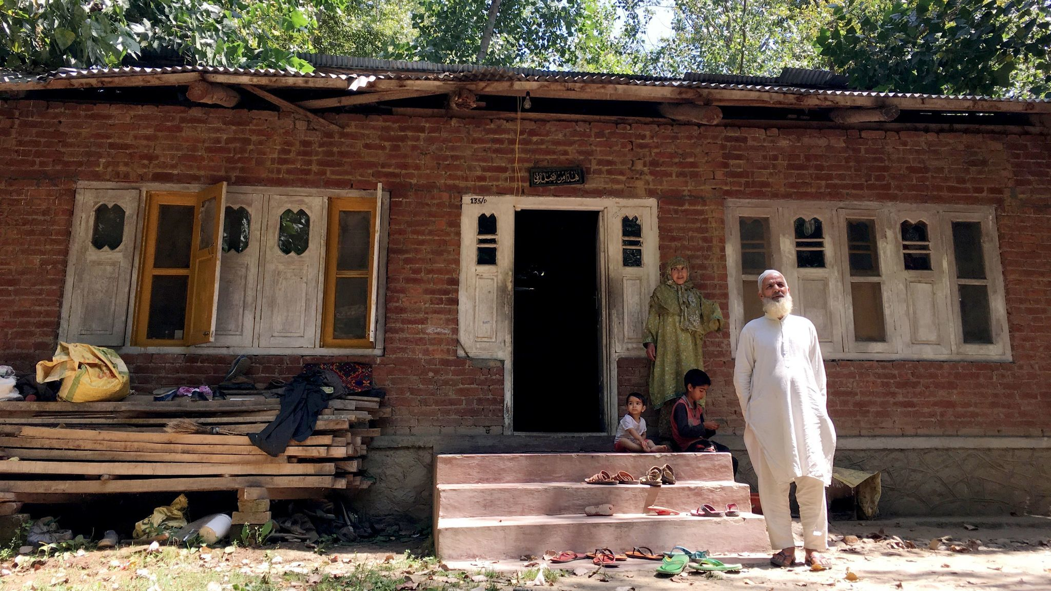 Mohammad Munawar Dar and his wife, Raja Begam, outside their house in Sopat Tangpora, in southern Kashmir.