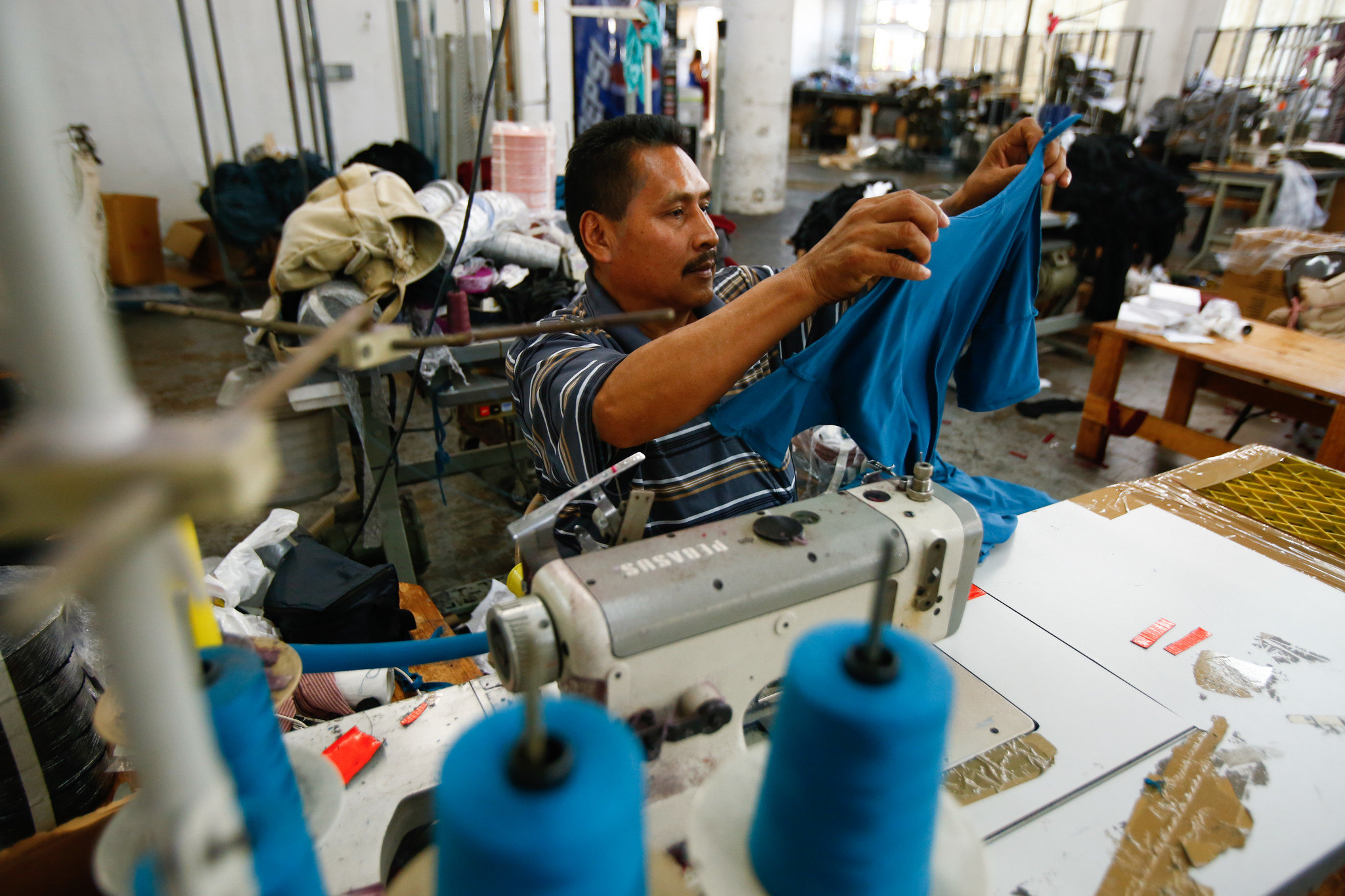 Behind A 13 Shirt A 6 An Hour Worker Los Angeles Times