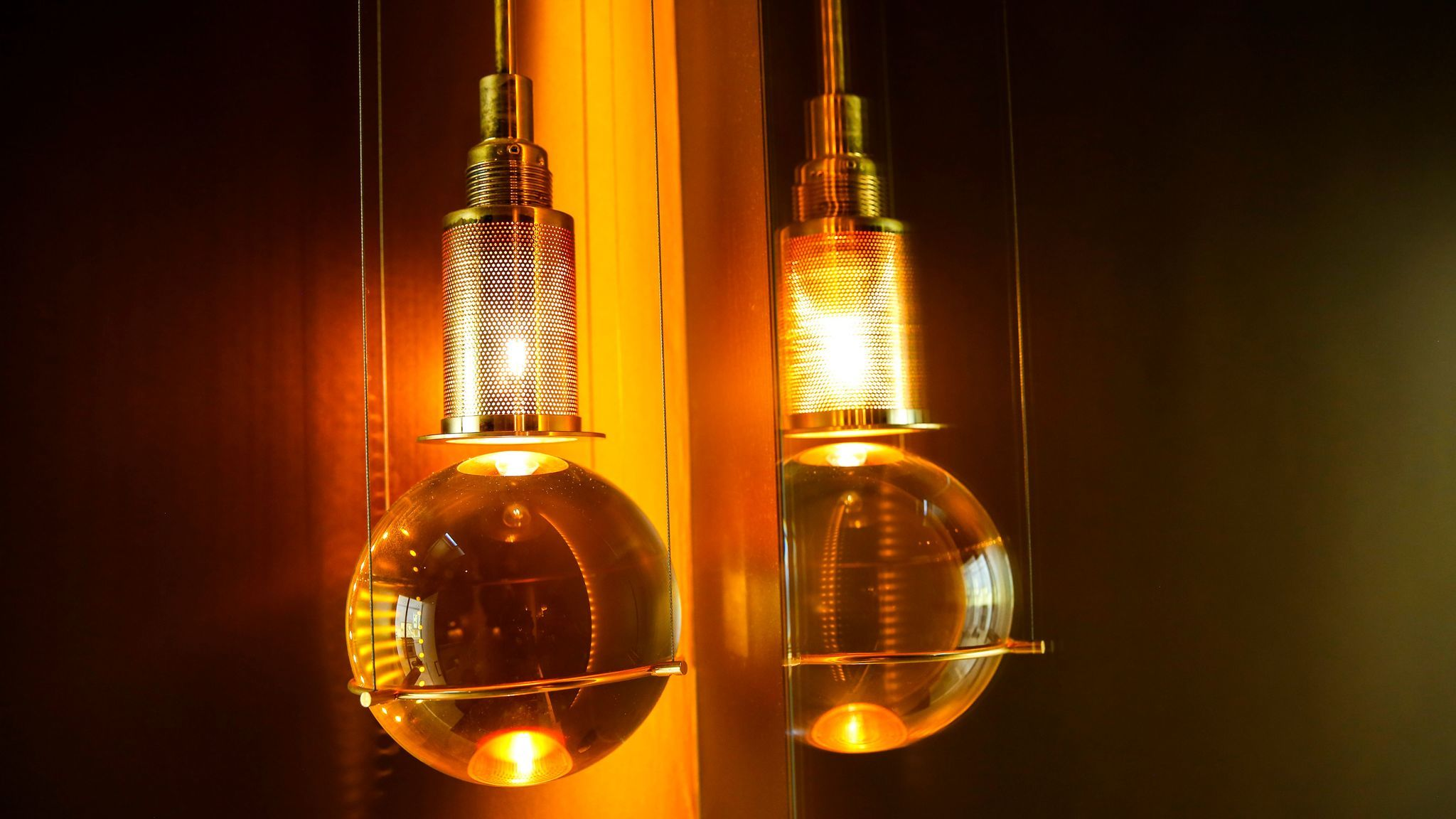 Postmodern pendant lamps by Günhter Leuchtmann hang in the powder room.