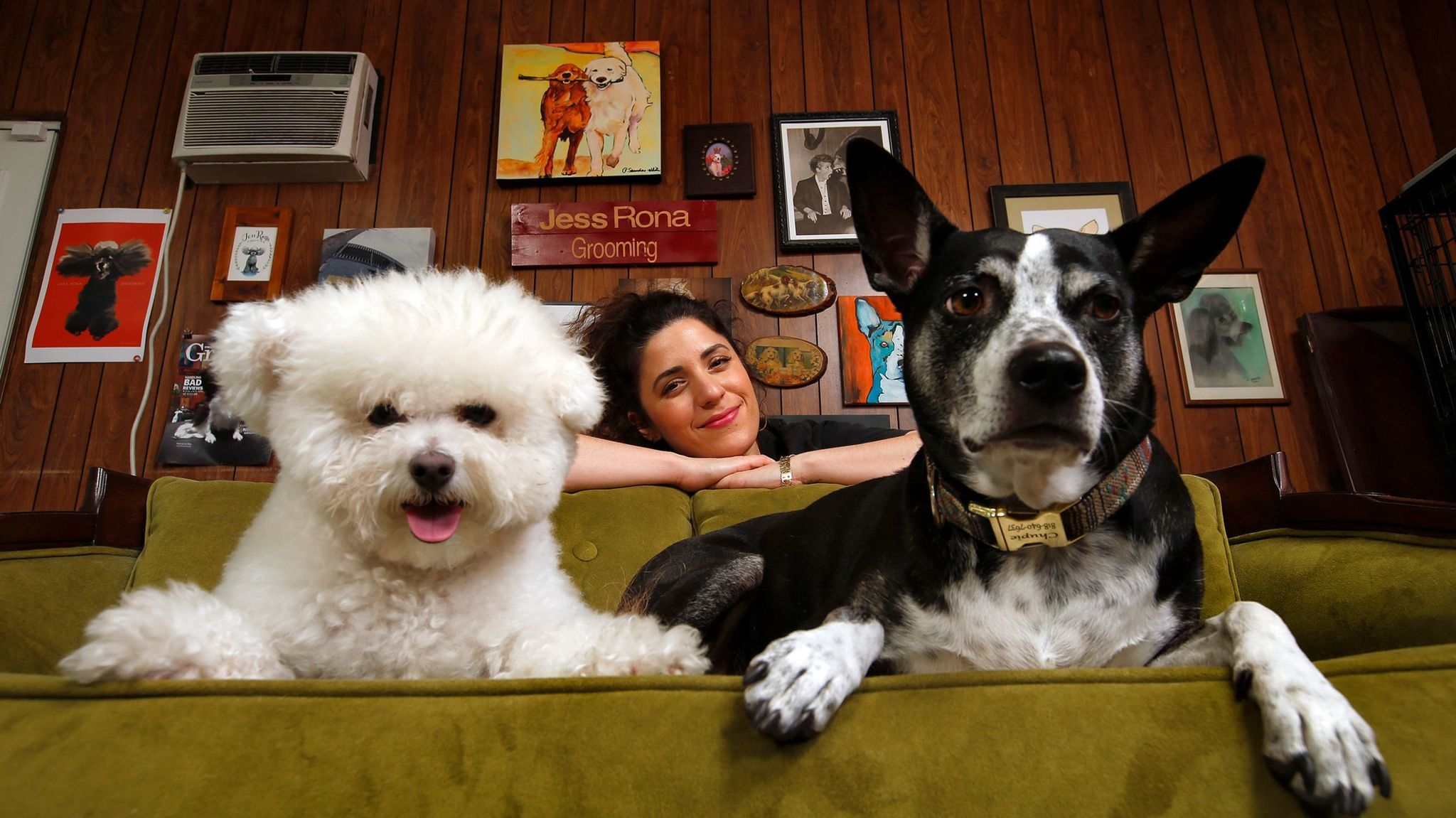 Dog grooming artist Jess Rona with Meemu, left, and Chupie, at her grooming studio in Los Angeles.