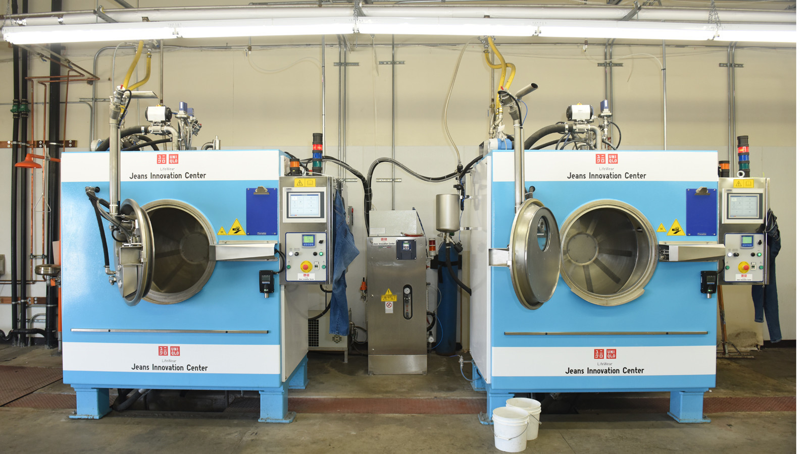 07ab6457 Industrial machines at the Jeans Innovation Center, where new denim pieces  get a vintage look. Uniqlo