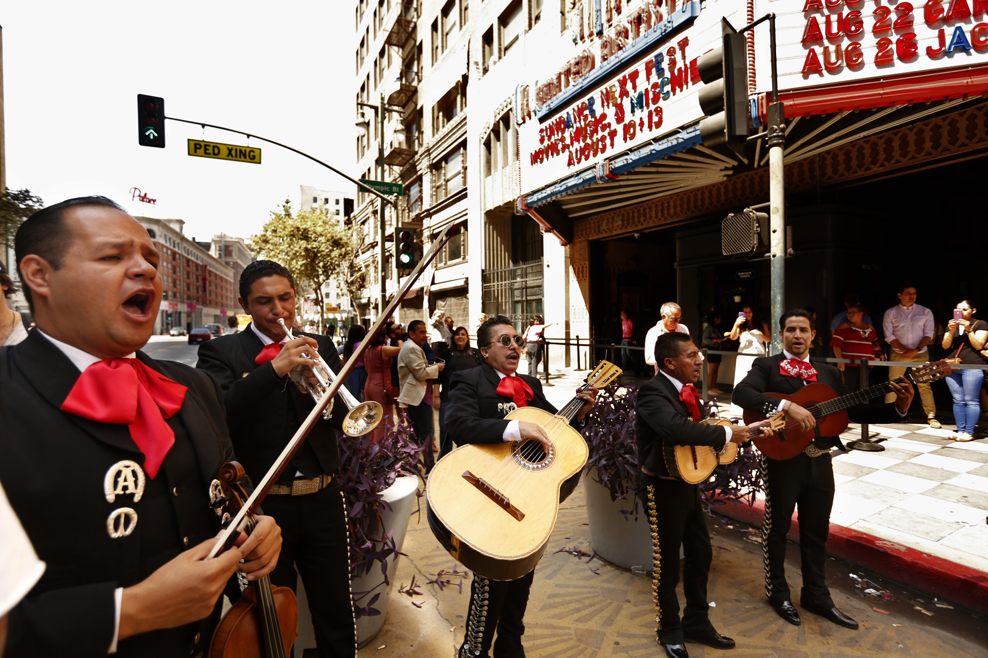 """Arturo Rubalcaba, from left, and Pedro Trujillo join mariachis Luis Valdivia, his brother, Enrique, and Moises Hernandez at the Sundance Nextfest screening of """"Gente-fied"""" at the Theatre at Ace Hotel in Los Angeles."""