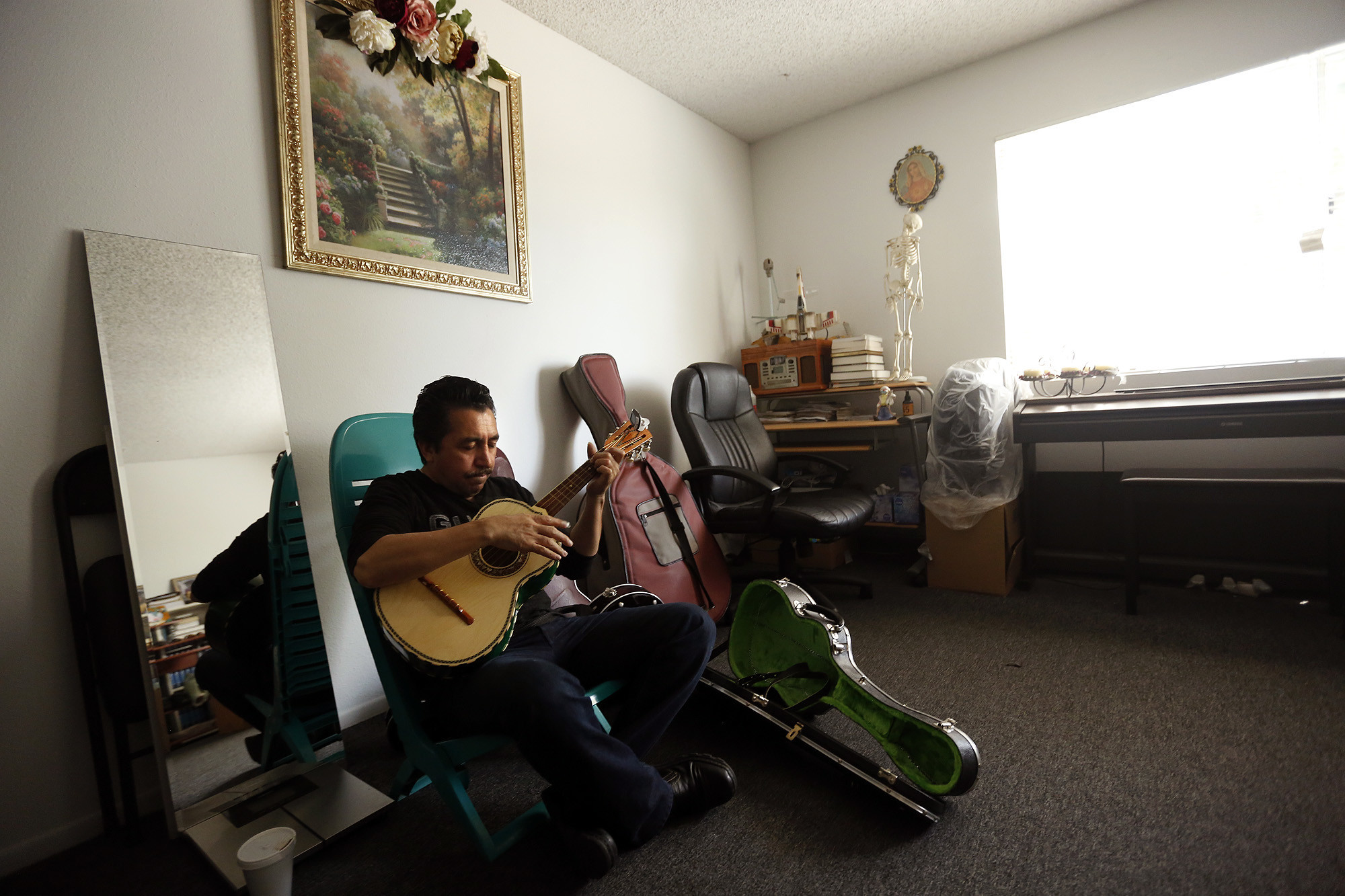Mariachi performer Luis Valdivia practices in his apartment in Boyle Heights. Valdivia and his brother, Enrique, face eviction because they are unable to keep up with an 80% rise in rent.