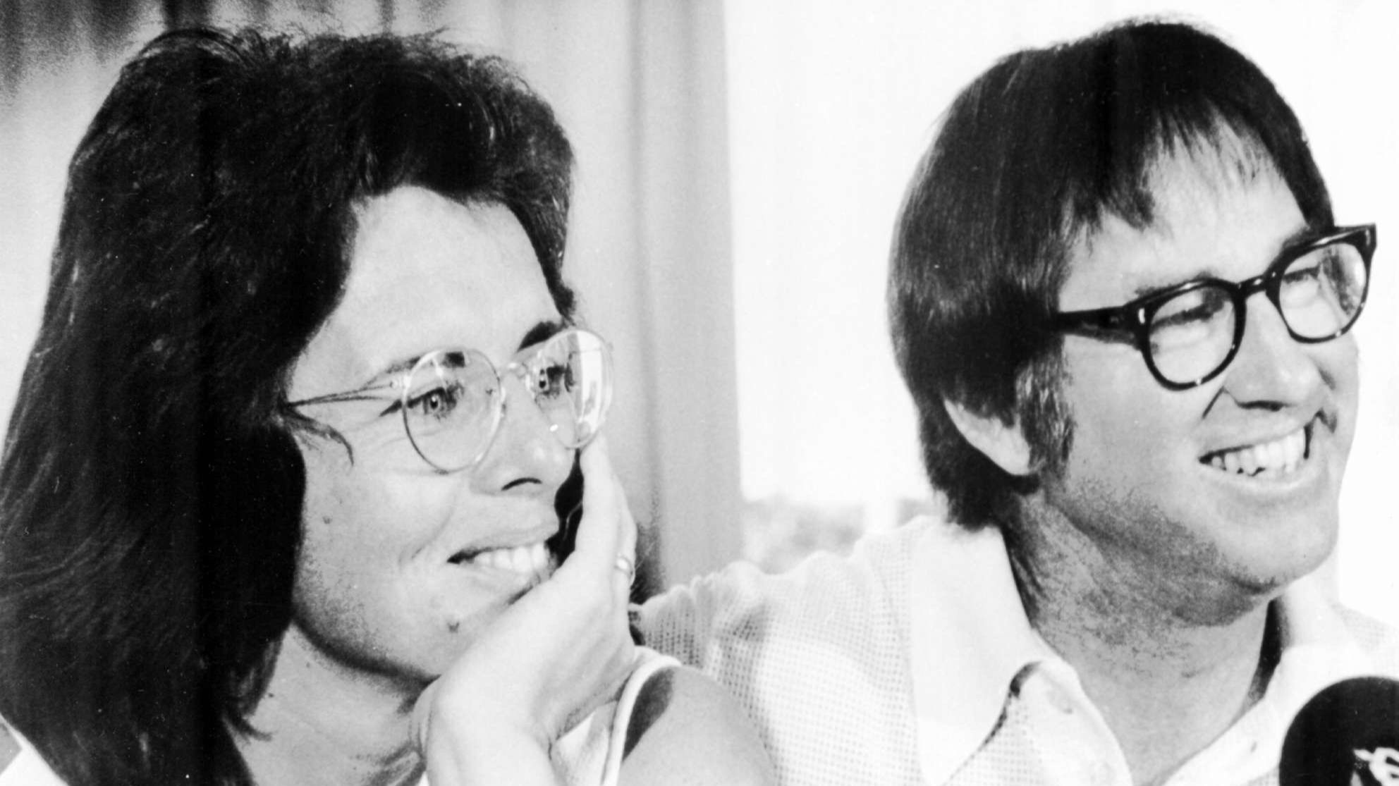 Billie Jean King and Bobby Riggs smile during a news conference in New York to publicize their upcoming match at the Houston Astrodome, in this July 11, 1973 photo.