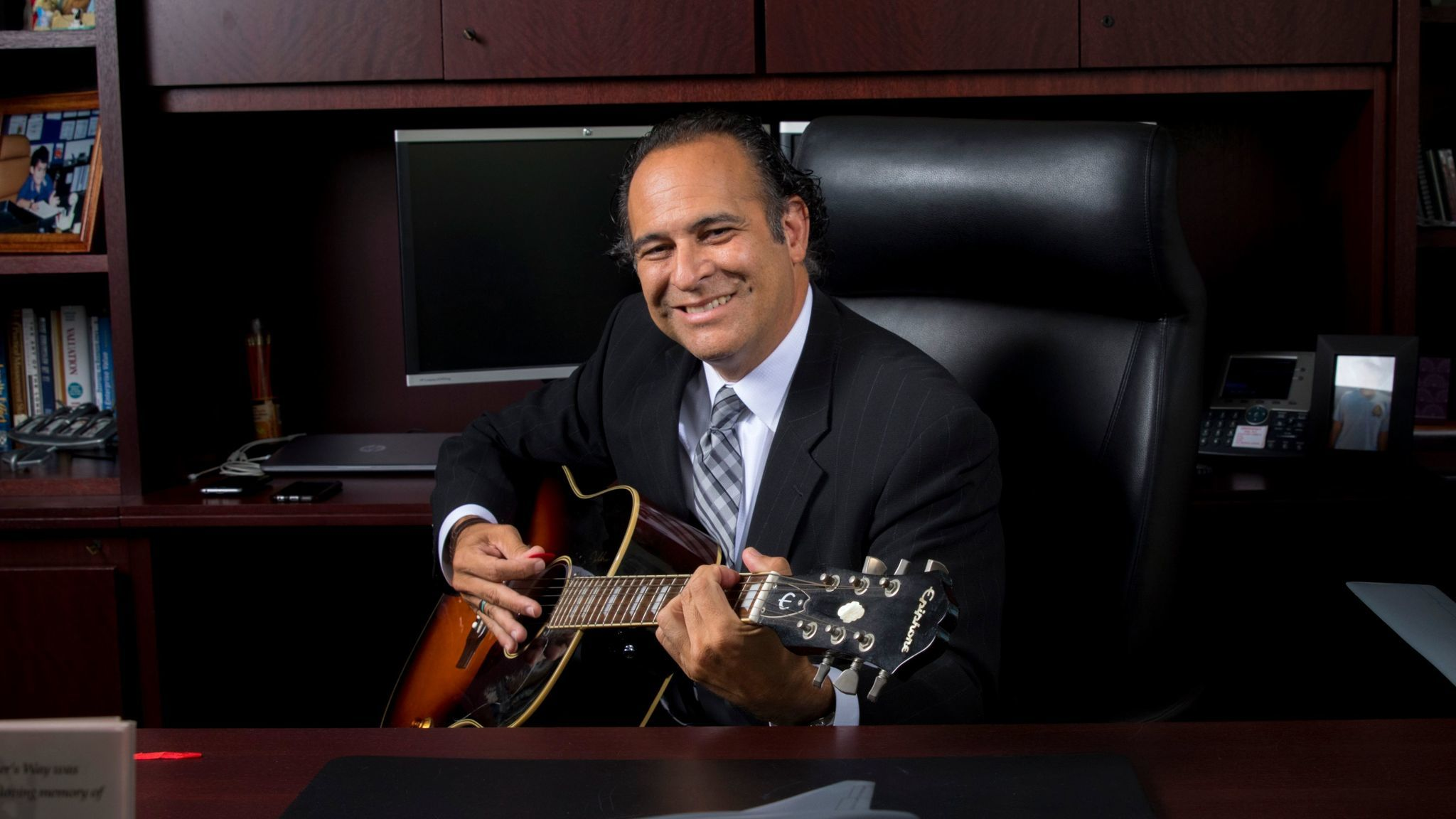 Northrop Grumman Corp. executive Chris Hernandez learned to play the guitar at the urging of one of his sons.