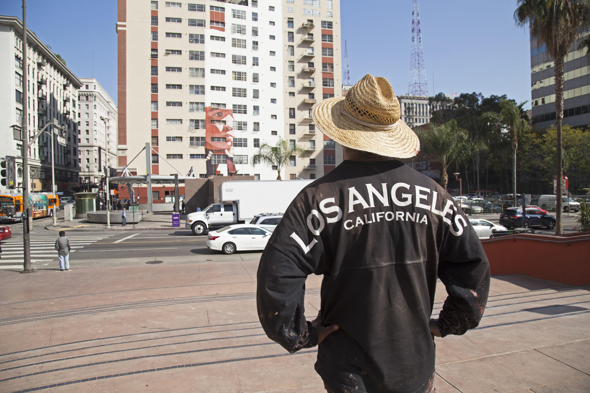 Robert Vargas examines his new mural from Pershing Square.