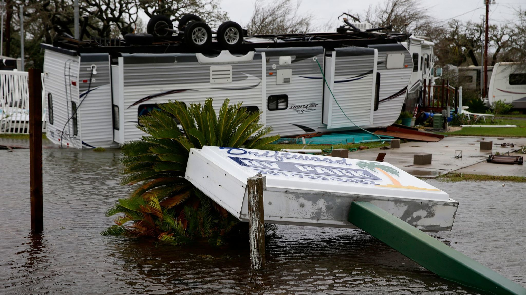 Motor homes are left strewn about the Driftwood RV Park the day after Hurricane Harvey struck Rockport, Texas.