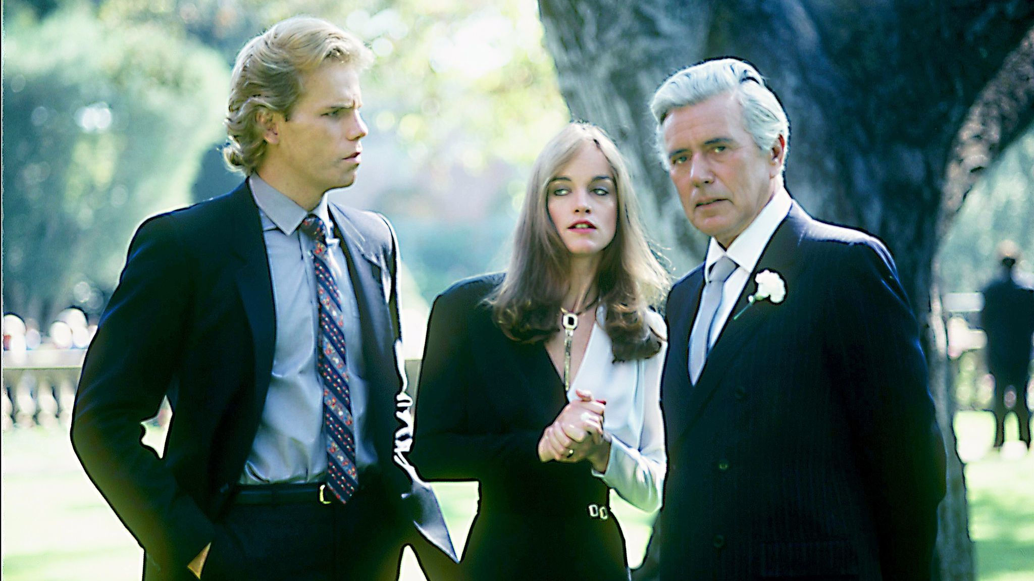 """Al Corley, Pamela Sue Martin and John Forsythe in a scene from the 1981 """"Dynasty"""" pilot."""
