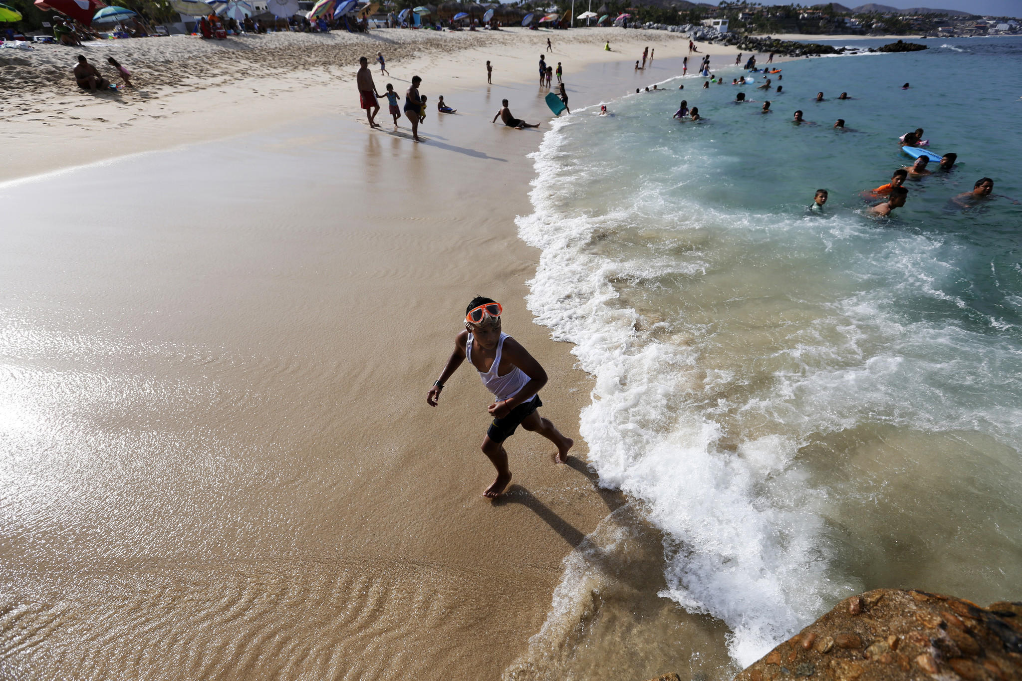 A Young Boy Plays In The Surf At Palmilla Beach Where Recently Three Men Were Killed By Group Of With Automatic Weapons San Jose Del Cabo Gary