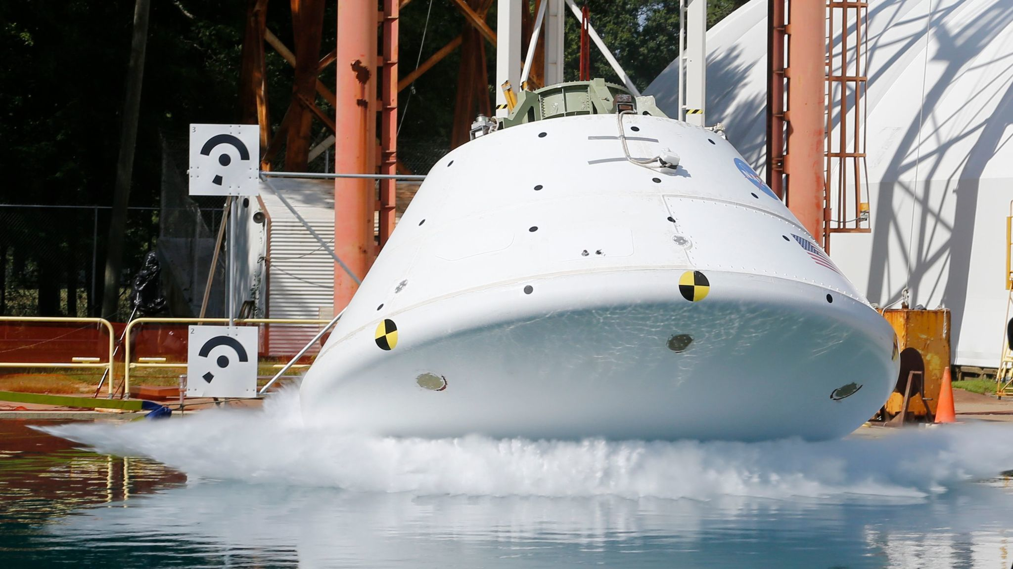 A mockup of NASA's Orion, which is designed to eventually travel to Mars, hits the water in a simulated ocean splashdown test at NASA Langley Research Center in Hampton, Va.