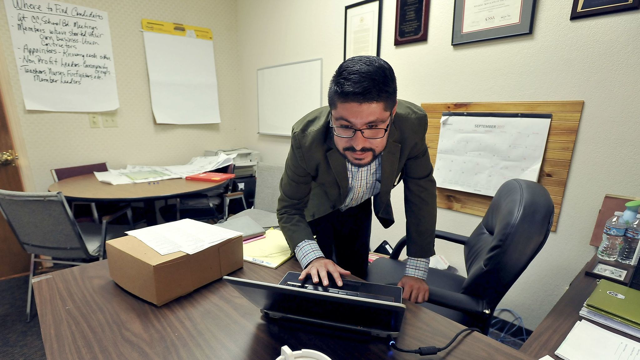 Pedro Ramirez, 28, checks his appointments while working in his office as a Central Valley field organizer for the California Labor Federation in Fresno.