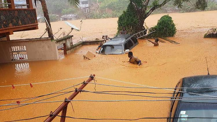 This picture shows flooded streets in Regent near Freetown, on Aug. 14, 2017.