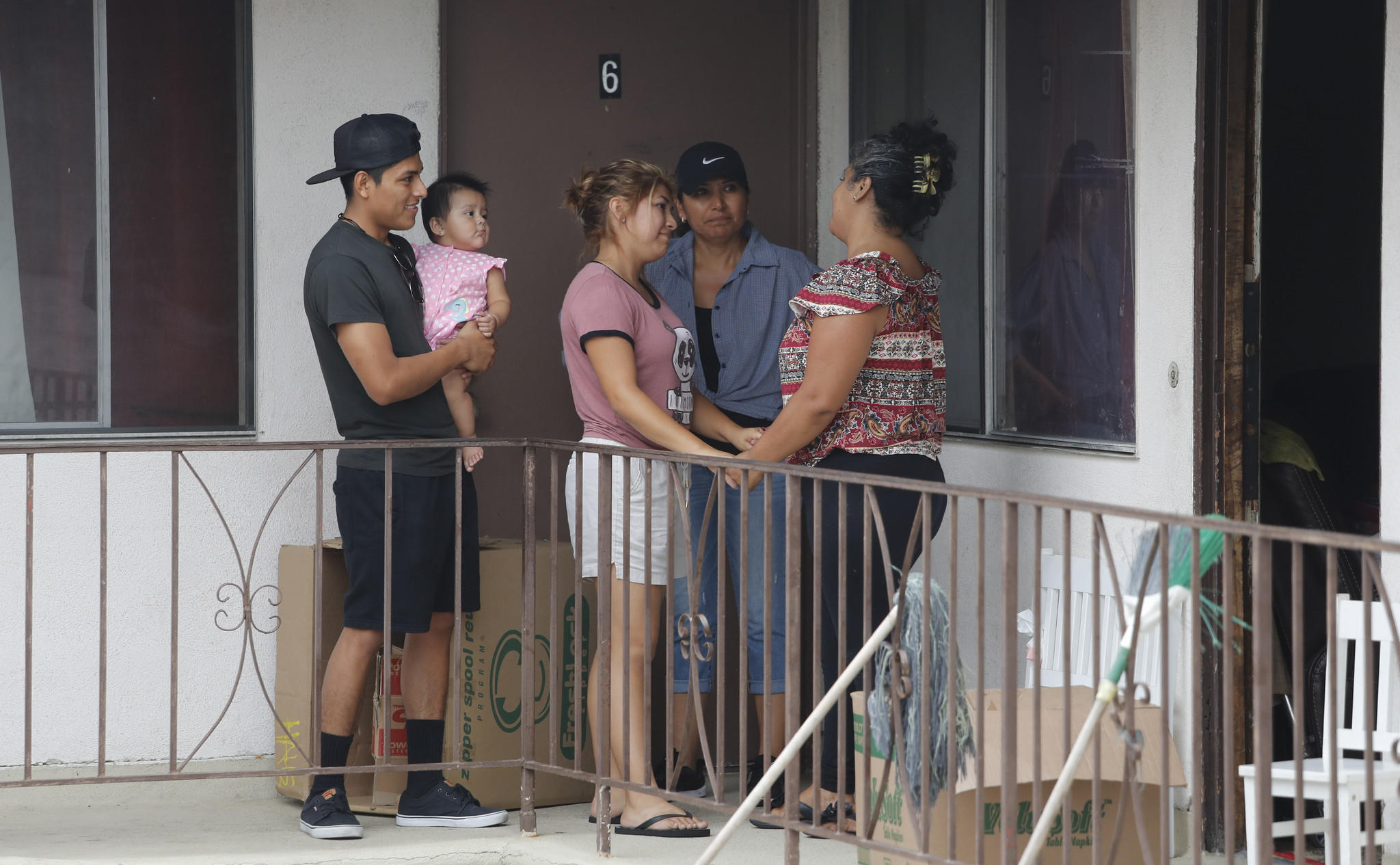 Maria Barrancas, right, bids farewell to neighbors on her family's last day in the United States.