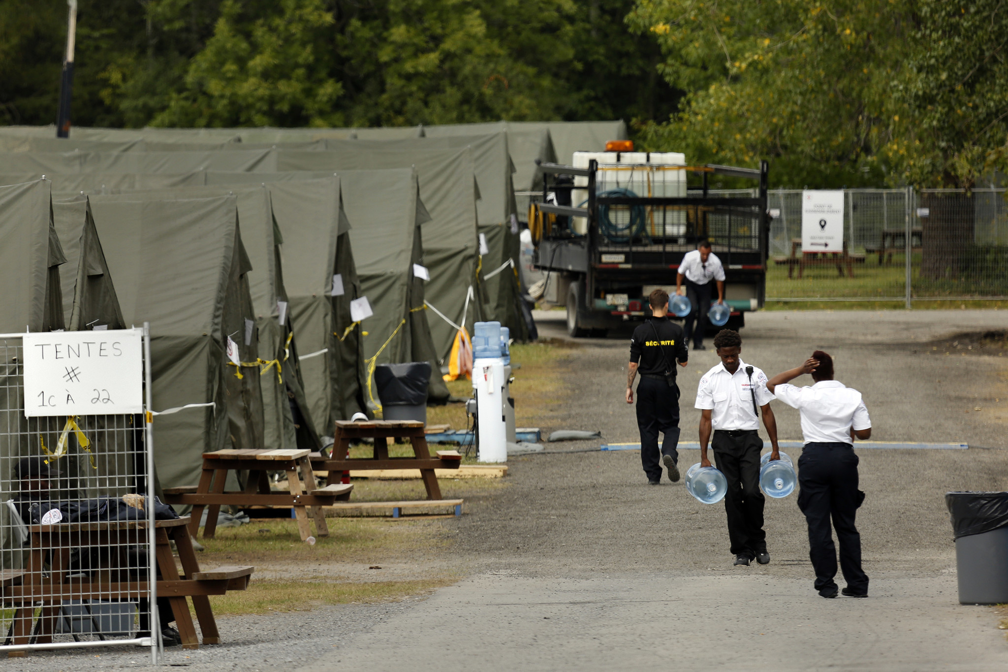 Members of the Canadian armed forces set up a tent village to house migrants while they wait to file asylum applications at the official port of entry in St. Bernard de Lacolle.