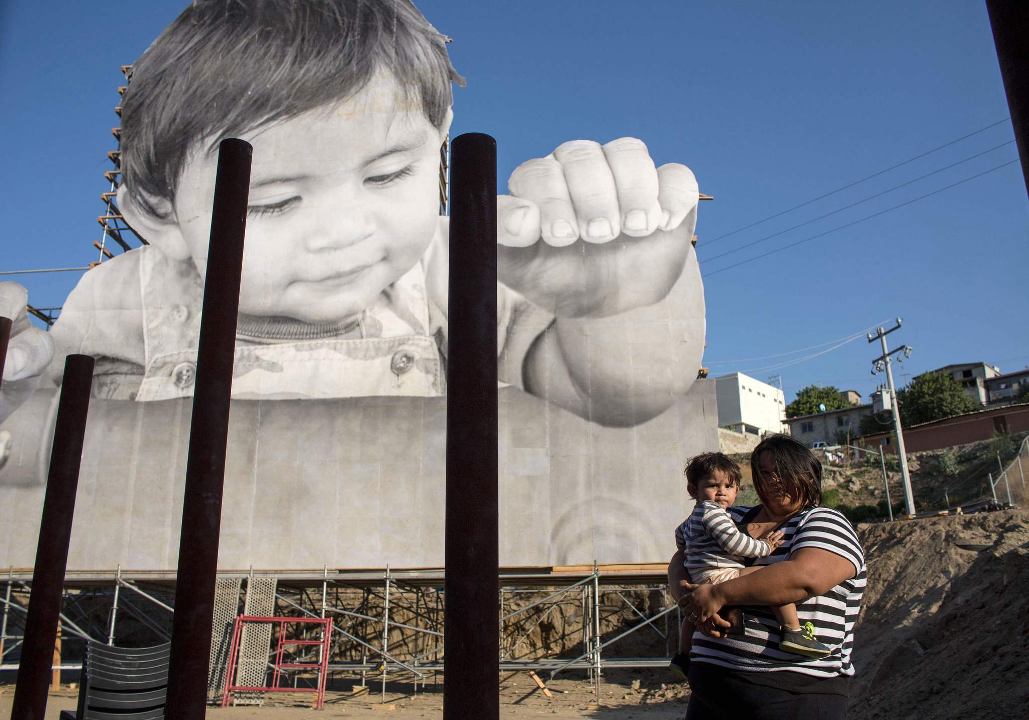 Lissy and her son Enrique Achondo, who served as a model for JR for his artwork installed on the U.S.-Mexico border.