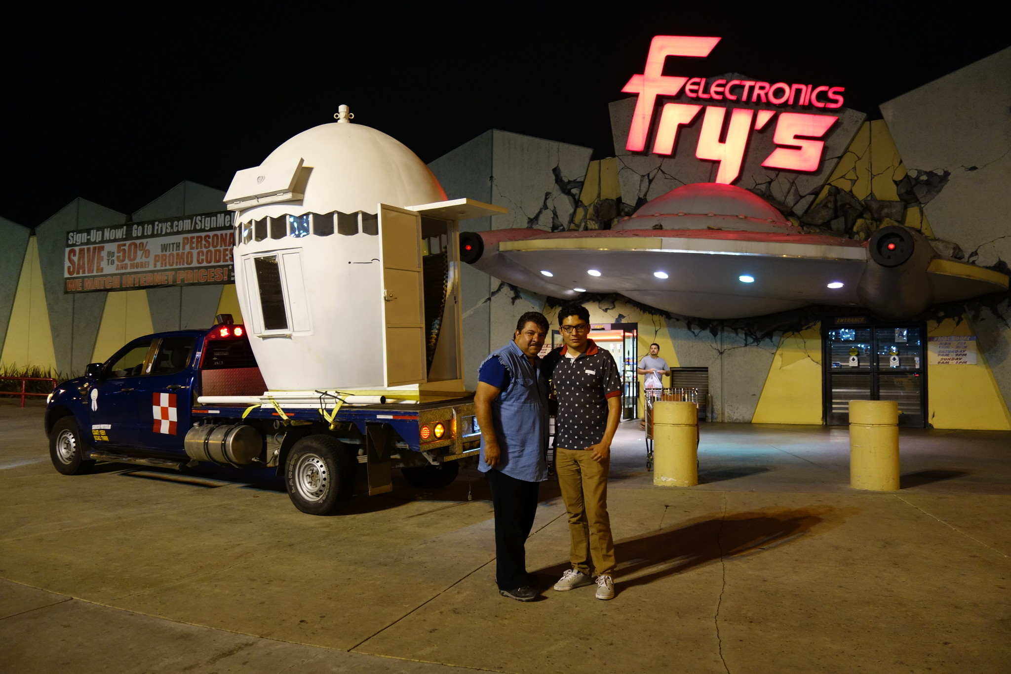 Driver Jose Jorge Rugerio and his son Jorge Andres Rugerio  pose before the NuMu at Fry's in Burbank.