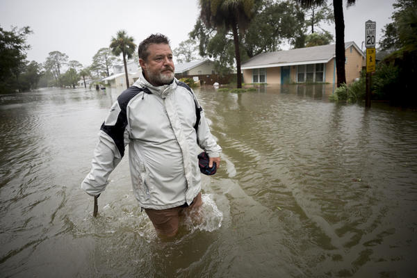Joey Spalding walks back to his truck on Tybee Island, Ga. (Stephen B. Morton / Associated Press)